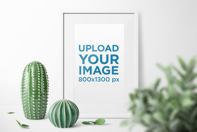 Poster Frame Mockup Featuring Some Porcelain Cactus 1934-el