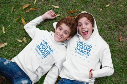 Pullover Hoodie Mockup Featuring Two Red-haired Twins Making Funny Faces 30699