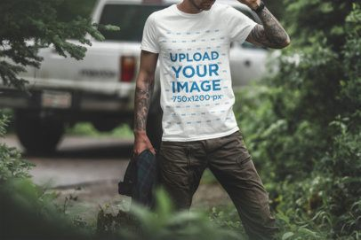 T-Shirt Mockup of a Tattooed Man in the Woods 1839-el1