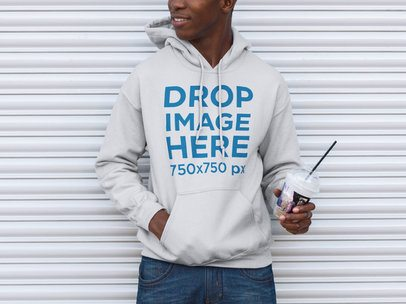 Mockup of a Young Black Man Wearing a Hoodie Holding His Coffee a9279