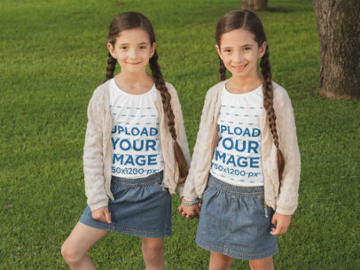 Long Sleeve Tee Mockup Featuring Twin Girls Holding Hands at a Park 30703