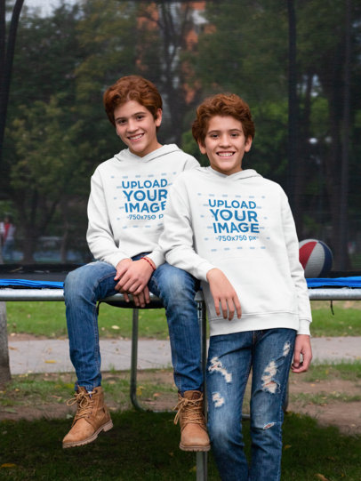 Mockup of Twin Boys Wearing Hoodies at the Park 30697