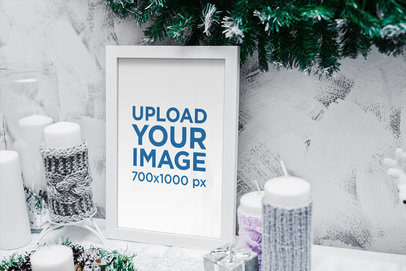 Mockup of an Art Print Surrounded by Christmas Candles 2091-el