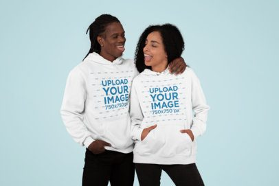 Multiple Hoodies Mockup Featuring a Couple at a Studio 30769