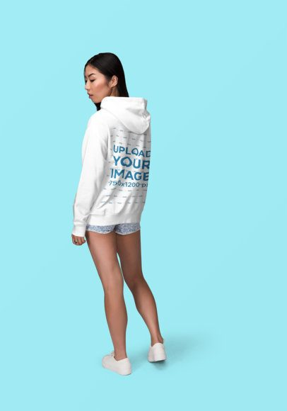 Back View Mockup of a Young Woman Wearing a Hoodie and Posing at a Studio1867-el