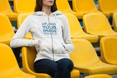 Mockup of a Woman Wearing a Customizable Full-Zip Hoodie at a Stadium 1790-el1