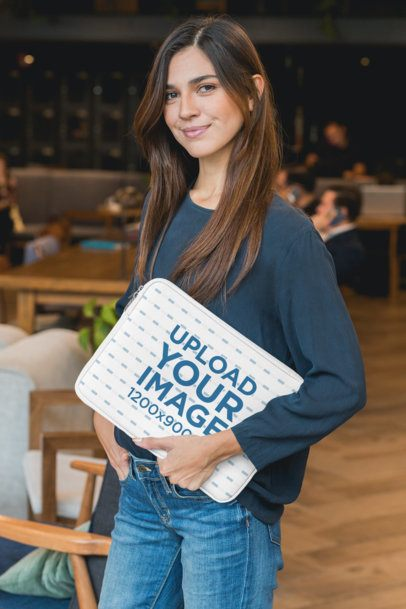 Laptop Sleeve Mockup Featuring a Woman at a Coworking Space 30847