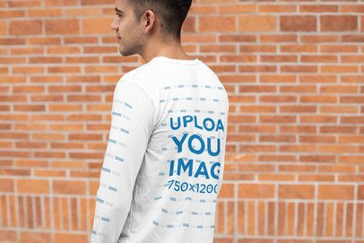 Long Sleeve Tee Mockup of a Man Posing in Front of a Brick Wall 30884