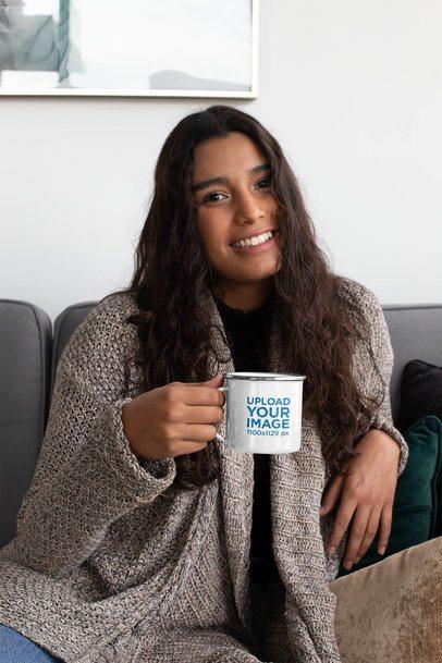 12 oz Enamel Mug Mockup Featuring a Woman Sitting on a Couch 30827