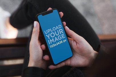 Mockup of a Relaxed Woman Using an iPhone 11 Pro 2128-el1
