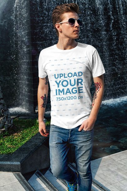 T-Shirt Mockup of a Cool Man Walking by a Fountain 2190-el1