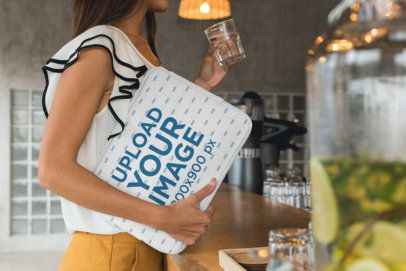 Laptop Sleeve Mockup Featuring a Woman at a Cafe 30854