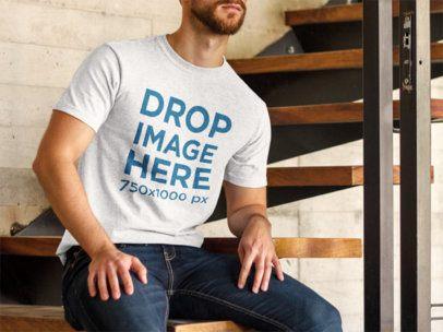 T-Shirt Mockup of a Bearded Man Sitting Down 8591