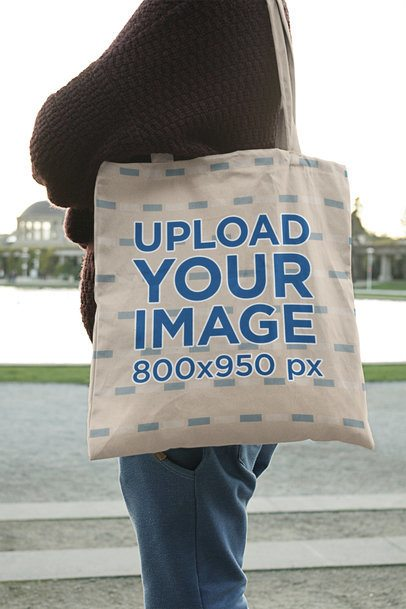 Tote Bag Mockup Featuring a Woman Casually Standing Outside 1992-el1