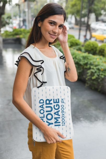 Mockup of a Woman Carrying a Laptop Sleeve on the Street 30857