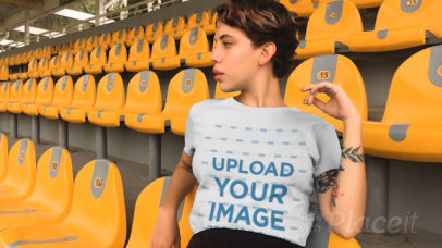 T-Shirt Video of a Woman Sitting in a Grandstand 23270