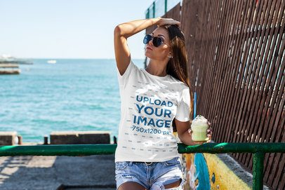 T-Shirt Mockup of a Woman Drinking a Smoothie at the Beach 2262-el1