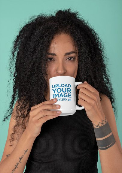 Mockup of a Tattooed Woman Drinking from a 15 oz Mug 30823