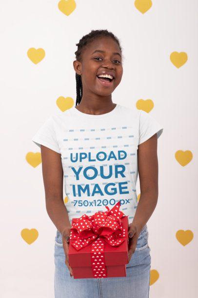 T-Shirt Mockup Featuring a Joyful Woman Holding a Present 31214