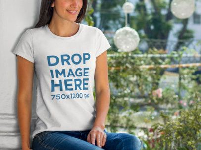 T-Shirt Mockup of a Smiling Young Woman at a Garden 8362