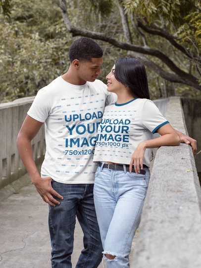 Mockup of a Man with a T-Shirt and a Woman with a Ringer Crop Top at a Park 20529