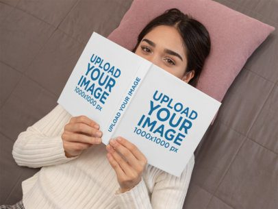 Mockup of a Woman Lying Down Holding a Book 31039
