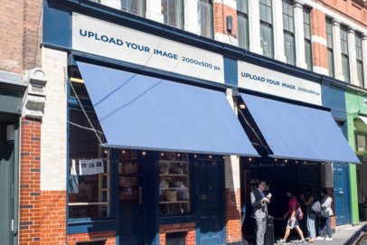 Storefront Mockup Featuring a Banner on a Blue Store 584-el1
