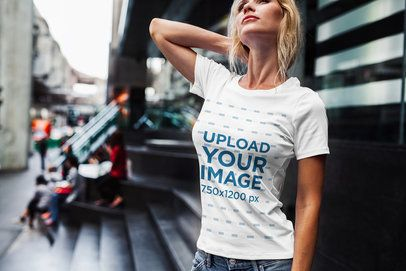 T-Shirt Mockup of a Blonde Woman Posing Outside of a Building 2232-el1