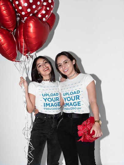 T-Shirt Mockup Featuring an LGBT Couple Holding Red Balloons and a Gift 31231