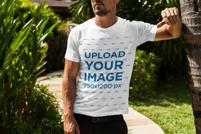 T-Shirt Mockup of a Bearded Man Leaning on a Palm Tree 2254-el1