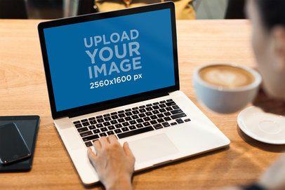 MacBook Pro Mockup Featuring a Person Drinking Coffee 2326-el1