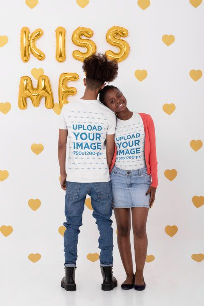 Both Sides T-Shirt Mockup of  a Young Couple at a Studio With Valentine's Decorations 31221