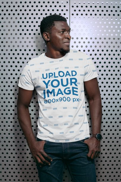 Sublimated Tee Mockup Featuring a Man Against a Grid Wall 31376