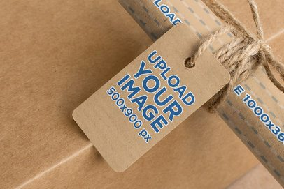 Mockup of a Cardboard Brand Tag Tied to a Kraft Wrapping Paper Roll 1300-el1