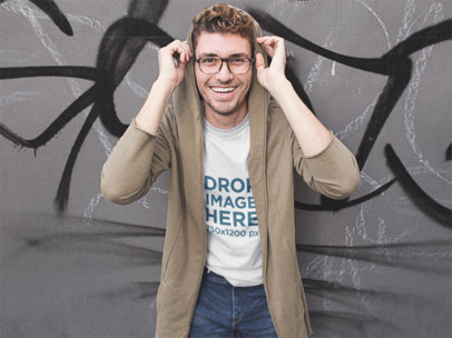 Mockup of a Smiling Hipster Guy Wearing a T-Shirt and Jacket Outside a11536