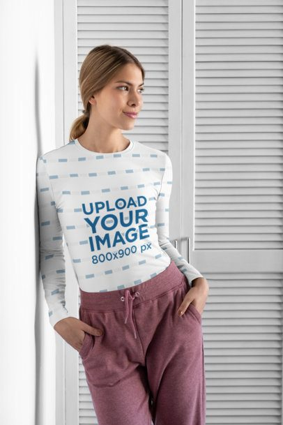 Sublimated Long Sleeve Tee Mockup Featuring a Woman Leaning Against a Wall 31263