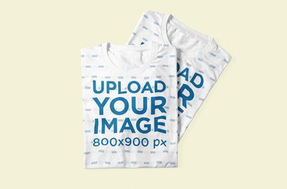 Mockup Featuring Two Sublimated Crew-Neck T-Shirts Placed on a Colored Surface 1055-el1