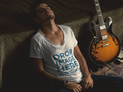 Mockup of an Alternative Guy Wearing a T-Shirt with His Guitar a111680