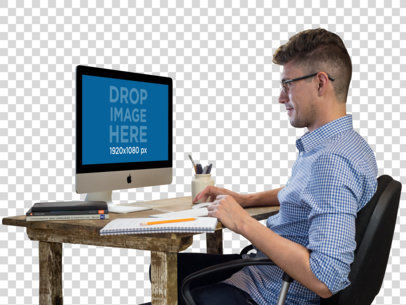 iMac Mockup of a Man Working at His Desk a11727