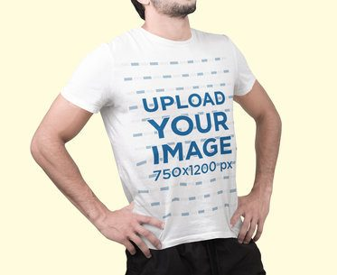 Mockup Featuring a Man Wearing a T-Shirt and a Customizable Background 2369-el1