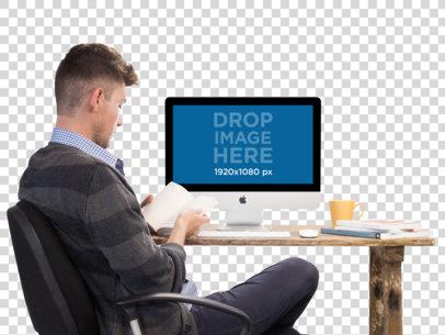 iMac Mockup of a Man Reading at His Desk a11725