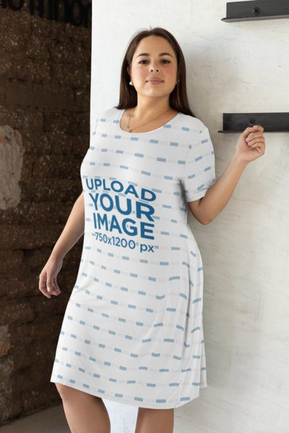 Mockup of a Woman with a Plus Size Shift Dress Leaning Against a Wall 31071