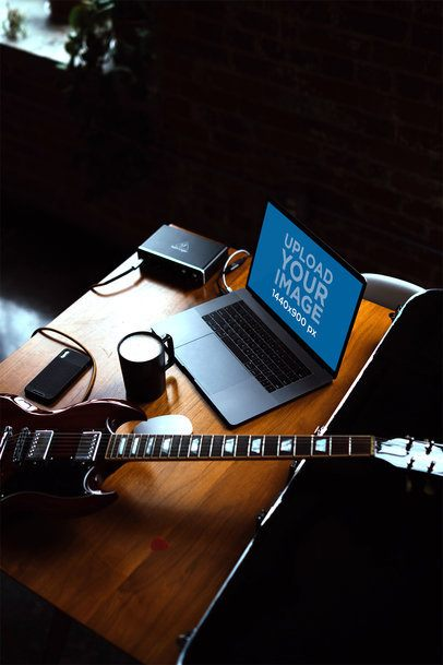 MacBook Pro Mockup Placed Next to a Guitar 2449-el1