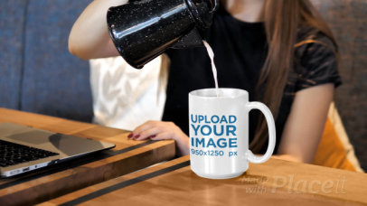 Video of a Woman Pouring a Hot Drink Into a 15 oz Mug 31591