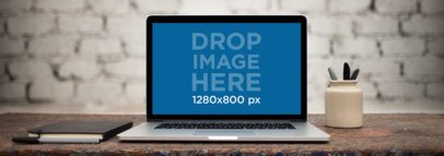 Wide Shot MacBook Pro Mockup in Front of a White Brick Wall a11766