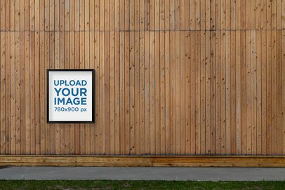 Mockup of a Poster Frame Placed on a Wooden Wall by a Street 2481-el1