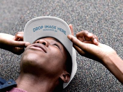 Hat Mockup of a Black Guy Lying on the Ground Looking Up 11771