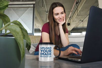 11 oz Magic Mug Mockup Featuring a Woman Using Her Laptop 31593