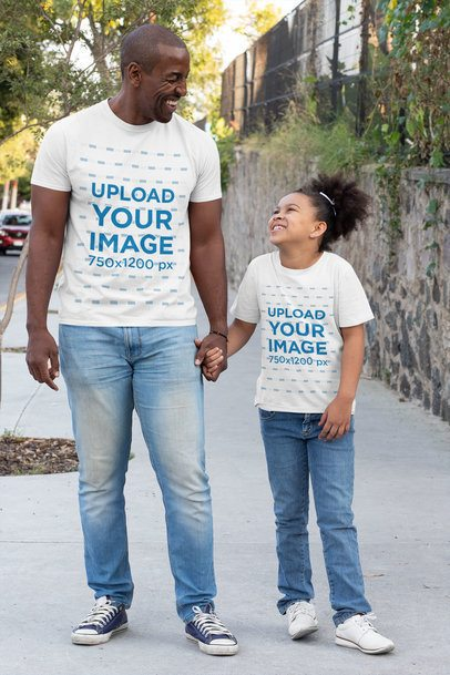 Mockup of a Dad and His Child Wearing T-Shirts on the Street 31392