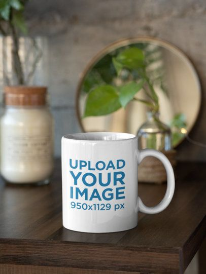 Mockup of an 11 oz Coffee Mug Next to Some Home Decorations 31310